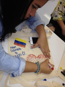 A Colombian exchange students gives an artistic touch to a care package on Global Youth Service Day this year.