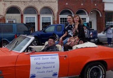 Joe proudly drives Claudia in the homecoming parade last fall.