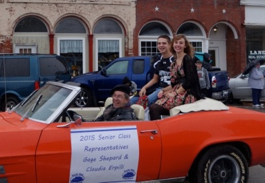 Joe proudly drives Claudia in the homecoming parade last fall.