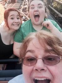 Kathy, Mackenzie, and Sarah taking a selfie on Thunder Mountain Railroad in Disneyland