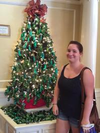 "Sarah posing with the ""pickle"" tree in Epcot"