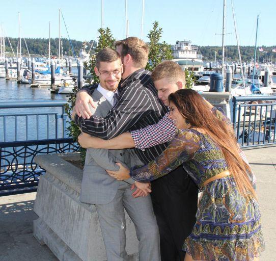 Jake group sibling hug