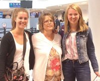 Adele Justice, center, welcomes the foreign exchange students to America at the Salt Lake International Airport, Laure Anne Bya and Lili Zoe Peetz.