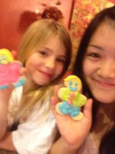Anna and her host sister showing off the cookies they baked together