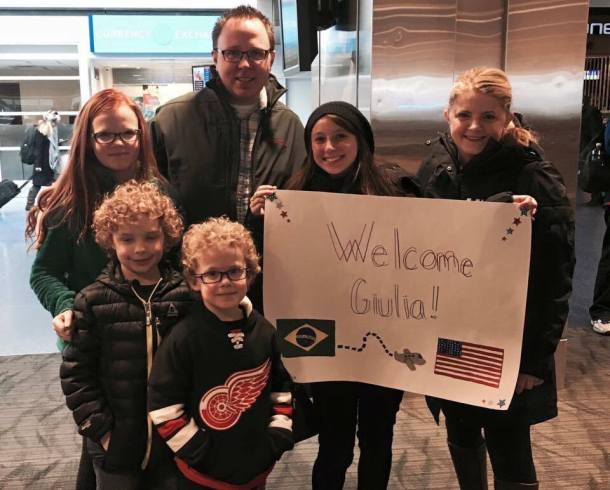 Sean and his family welcoming Giúlia from Brazil at the airport.