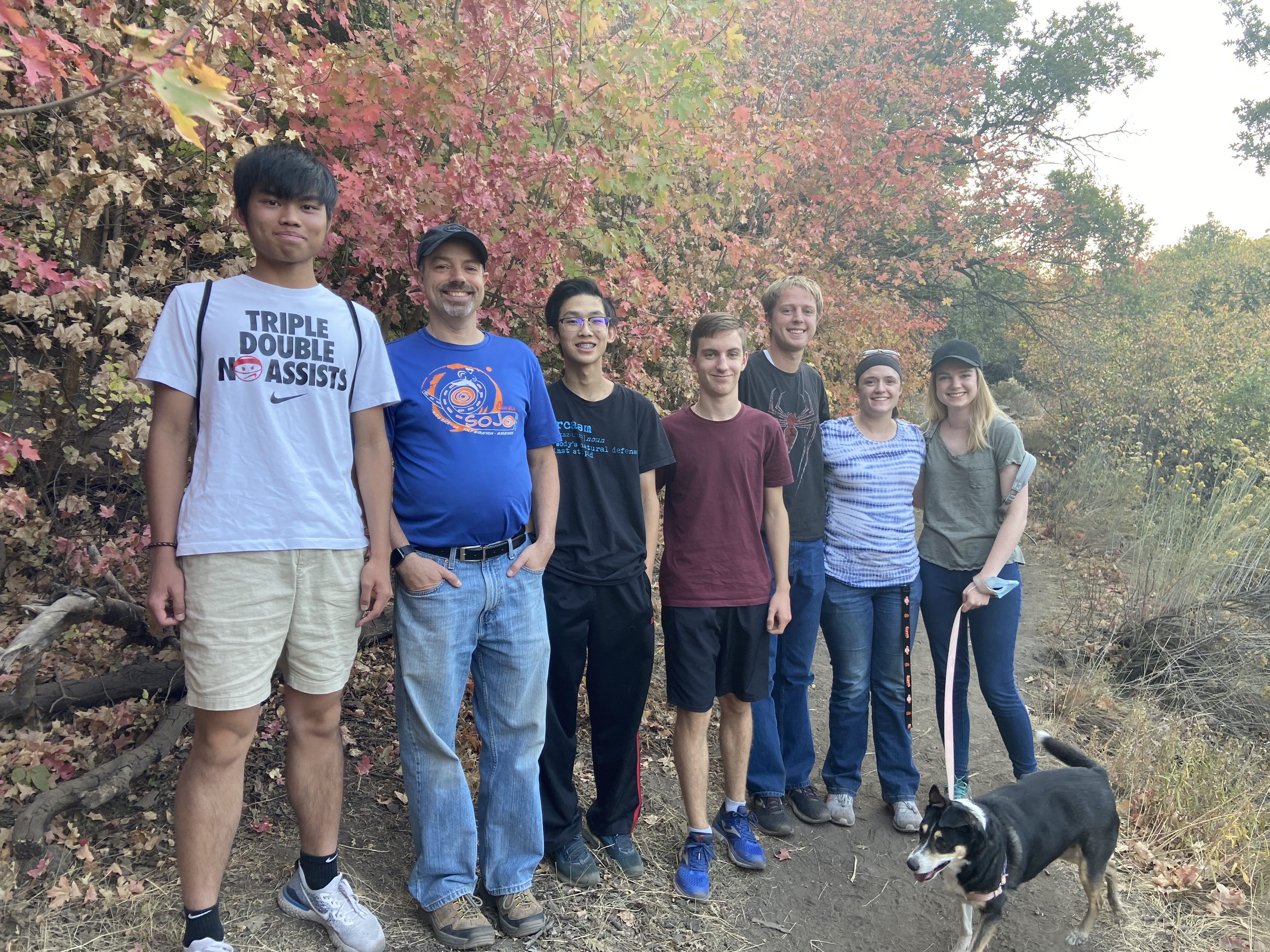 Chung Ming from Hong Kong (left) and Rafael from Spain (red shirt) with their hosts the McPherson Family on a nice Fall hike.