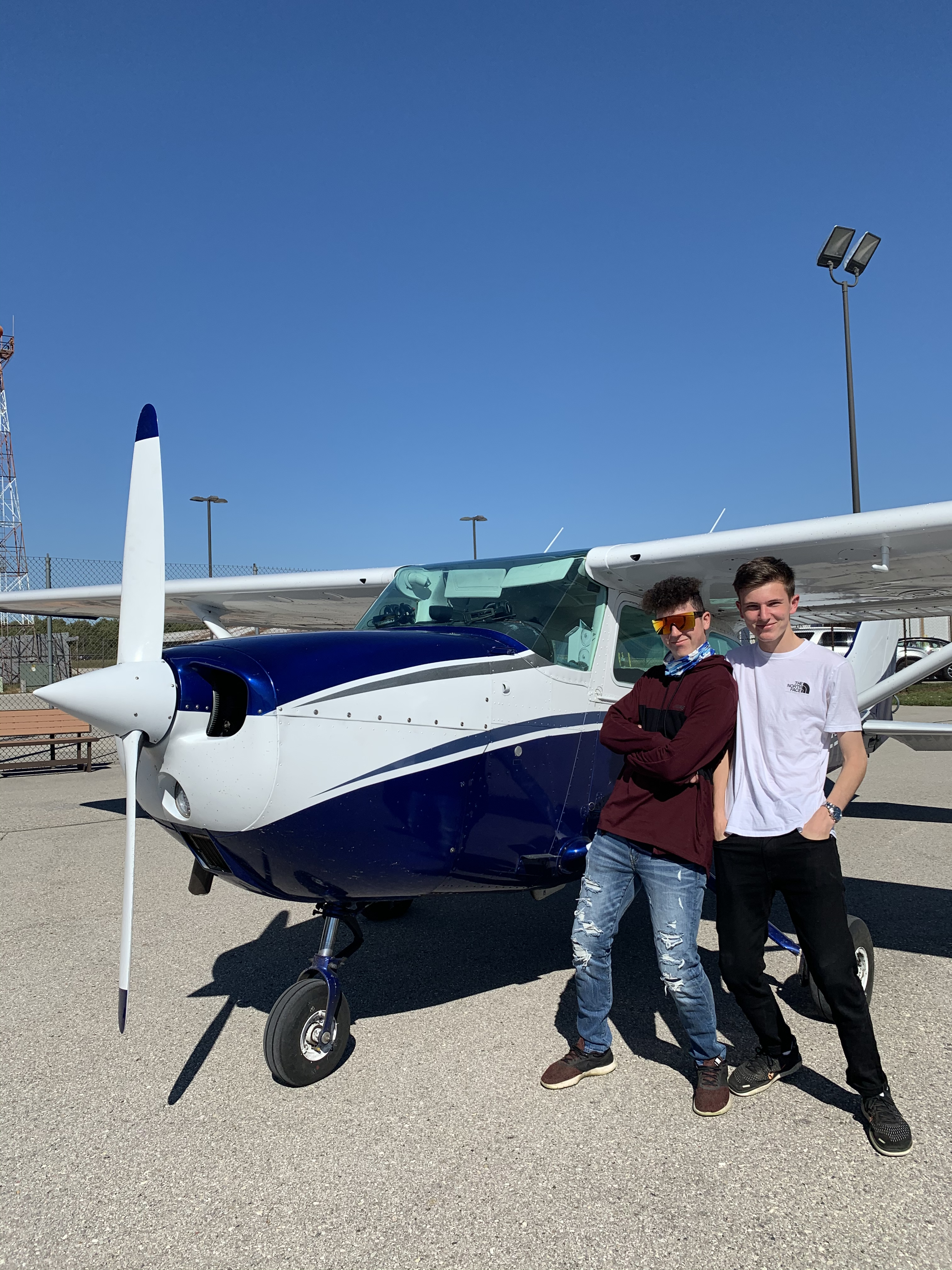 Elias from Germany (right) with his host brother after having fall scenic color plane ride at the local airport, where they flew over their town and house.